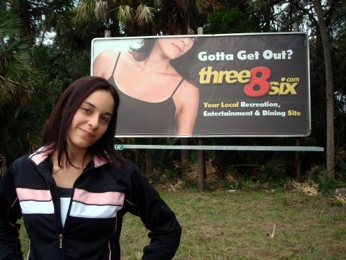 Sarah Posing With Her Three8Six.com Billboard